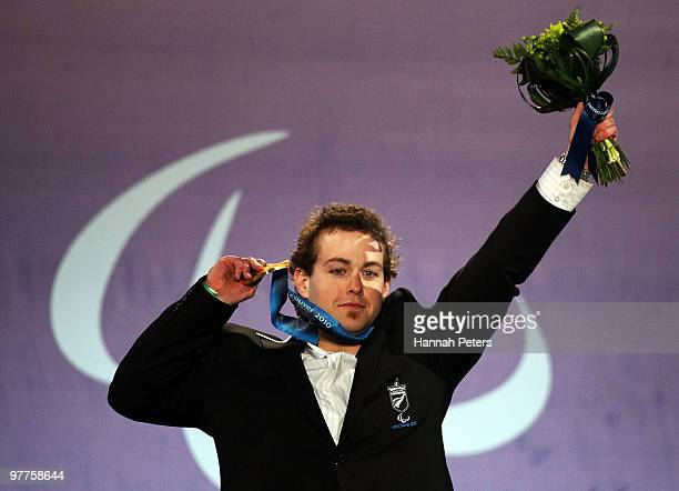 Gold medalist Adam Hall of New Zealand celebrates during the medal ceremony for the Men's Standing Slalom on Day 4 of the 2010 Vancouver Winter...