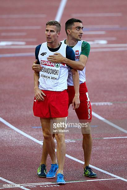 Gold medalist Adam Kszczot of Poland hugs Marcin Lewandowski of Poland after the Men's 800 metres final during day four of the 22nd European...