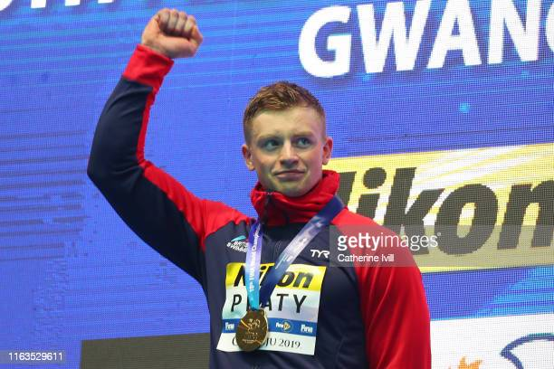Gold medalist Adam Peaty of Great Britain celebrates during the medal ceremony of the Men's 100m Breaststroke Final on day two of the Gwangju 2019...
