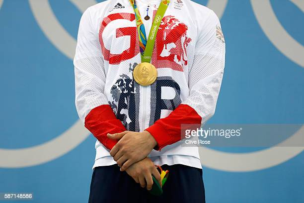 Gold medalist Adam Peaty of Great Britain poses on the podium during the medal ceremony for the Men's 100m Breaststroke Final on Day 2 of the Rio...