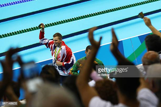 Gold medalist Adam Peaty of Great Britain thanks the crowd during the medal ceremony for the Men's 100m Breaststroke Final on Day 2 of the Rio 2016...
