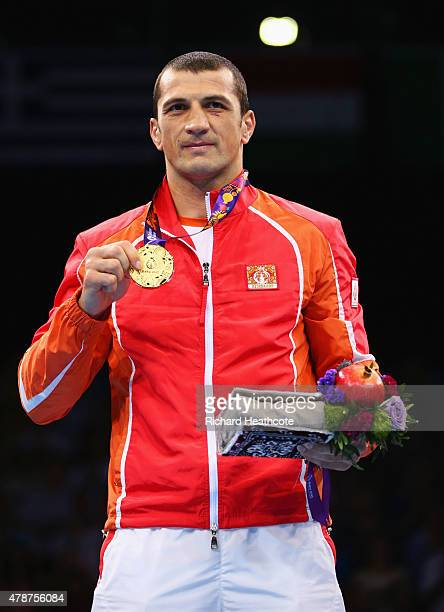 Gold medalist Adbulkadir Abdullayev of Azerbaijan stands on the podium during the medal ceremony for the Men's Heavyweight 91kg during day fifteen of...