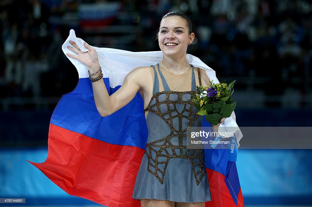 Gold medalist Adelina Sotnikova of Russia celebrates during the flower ceremony for the Ladies' Figure Skating on day 13 of the Sochi 2014 Winter Olympics at Iceberg Skating Palace on February 20, 2014 in Sochi, Russia.