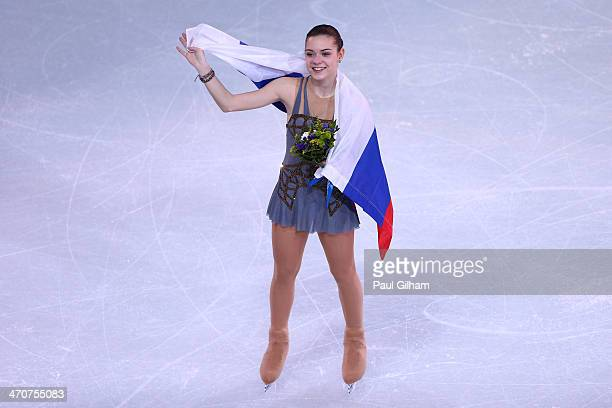 Gold medalist Adelina Sotnikova of Russia celebrates during the flower ceremony for the Ladies' Figure Skating on day 13 of the Sochi 2014 Winter...