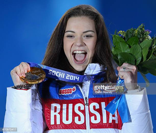 Gold medalist Adelina Sotnikova of Russia celebrates during the medal ceremony for the Women's Free Figure Skating on day fourteen of the Sochi 2014...