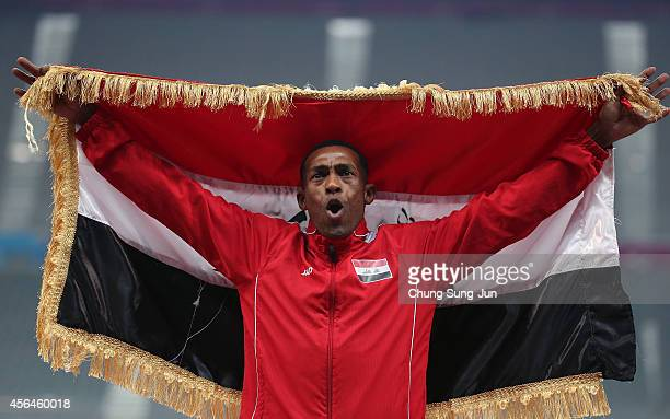 Gold medalist Adnan Taes Agar Almntfage of Iraq celebrates after winning the Men's 800m final on day twelve of the 2014 Asian Games at Incheon Asiad...