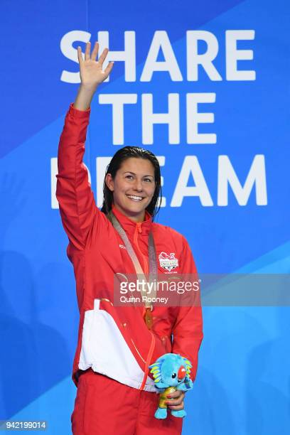 Gold medalist Aimee Willmott of England poses during the medal ceremony for the Women's 400m Individual Medley Final on day one of the Gold Coast...