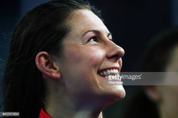 Gold medalist Aimee Willmott of England smiles during the medal ceremony for the Women's 400m Individual Medley Final on day one of the Gold Coast...