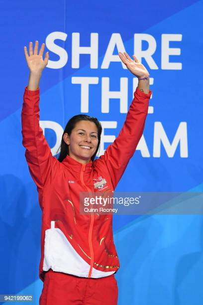 Gold medalist Aimee Willmott of England waves during the medal ceremony for the Women's 400m Individual Medley Final on day one of the Gold Coast...