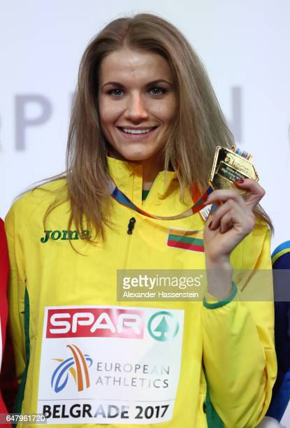 Gold medalist Airine Palsyte of Lithuania poses during the medal ceremony for the Women's High Jump on day two of the 2017 European Athletics Indoor...