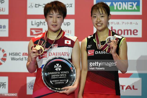 Gold medalist Akane Yamaguchi of Japan and silver medalist Nozomi Okuhara of Japan pose during the medal ceremony of the Women's Single Final on day...