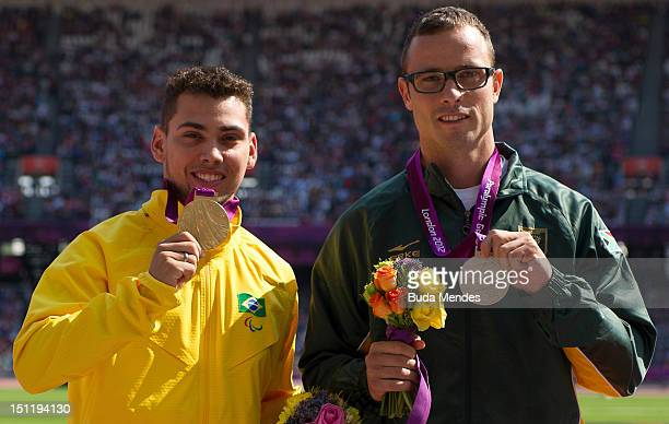 Gold medalist Alan Fonteles Cardoso Oliveira and Silver medalist Oscar Pistorius of South Africa during the medal ceremony on Day 5 of the London...