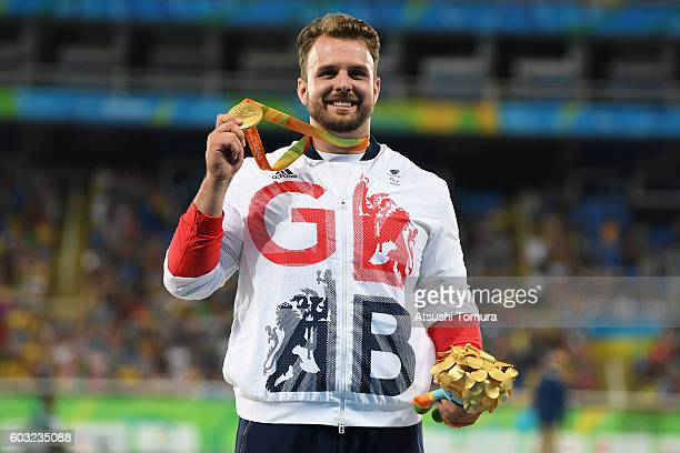 Gold medalist Aled Davies of Great Britain celebrates on the podium at the medal ceremony for the Men's Shot Put - F42 on day 5 of the Rio 2016...