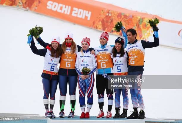 Gold medalist Aleksandra Frantceva of Russia and guide Pavel Zabotin pose with silver medalist Jade Etherington of Great Britain with guide Caroline...