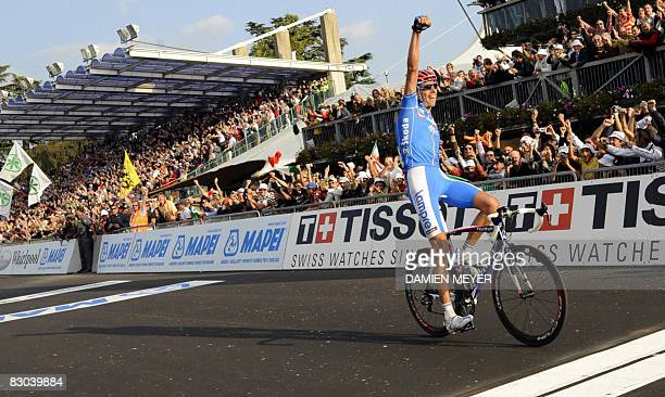 Gold medalist Alessandro Balan of Italy celebrates as he crosses the finish line of the elite men road race at the 2008 UCI road world championships...