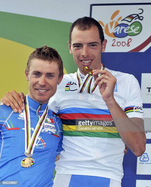 Gold medalist Alessandro Balan of Italy celebrates as he hugs his compatriot secondplaced Damiano Cunego on the podium of the elite men road race at...