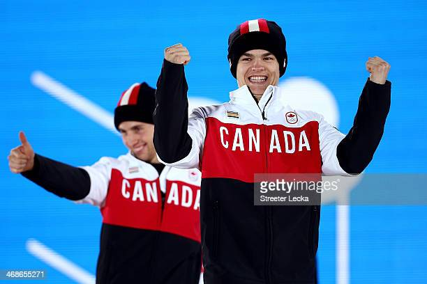 Gold medalist Alex Bilodeau of Canada and silver medalist Mikael Kingsbury of Canada celebrate during the medal ceremony for the Freestyle Skiing...