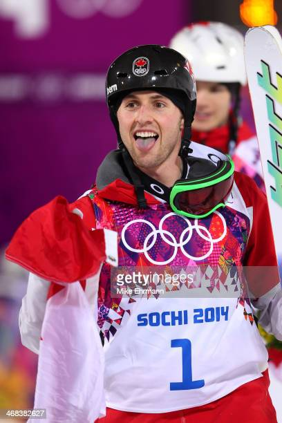 Gold medalist Alex Bilodeau of Canada celebrates after the Men's Moguls Finals on day three of the Sochi 2014 Winter Olympics at Rosa Khutor Extreme...