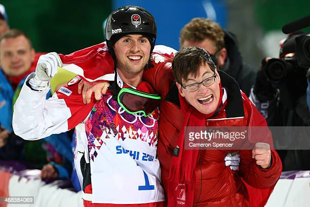 Gold medalist Alex Bilodeau of Canada celebrates with his brother Frederic after the flower ceremony for the Men's Moguls Finals on day three of the...
