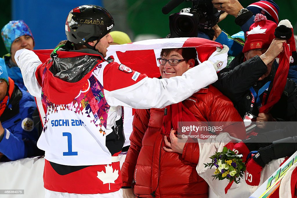 Gold medalist Alex Bilodeau of Canada celebrates with his brother Frederic after the flower ceremony for the Men's Moguls Finals on day three of the Sochi 2014 Winter Olympics at Rosa Khutor Extreme Park on February 10, 2014 in Sochi, Russia.