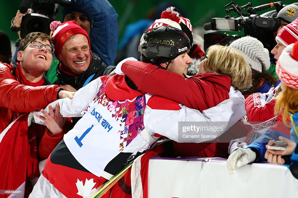 Gold medalist Alex Bilodeau of Canada celebrates with his mother after the flower ceremony for the Men's Moguls Finals on day three of the Sochi 2014 Winter Olympics at Rosa Khutor Extreme Park on February 10, 2014 in Sochi, Russia.