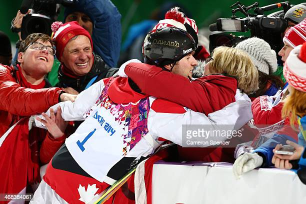 Gold medalist Alex Bilodeau of Canada celebrates with his mother after the flower ceremony for the Men's Moguls Finals on day three of the Sochi 2014...
