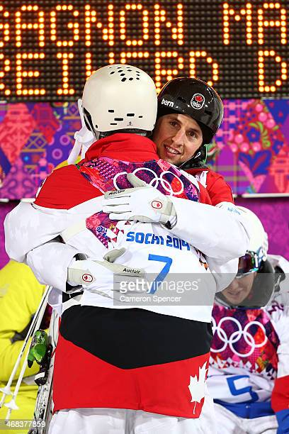 Gold medalist Alex Bilodeau of Canada is congratulated by MarcAntoine Gagnon of Canada after the Men's Moguls Finals on day three of the Sochi 2014...