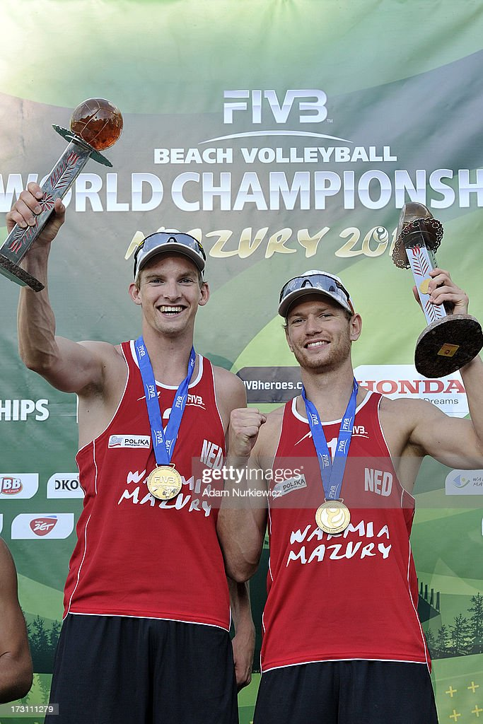 Gold medalist Alexander Brouwer (L) and Robert Meeuwsen (R) of the Netherlands celebrate their victory after the men's final match between the Netherlands and Brazil during Day 7 of the FIVB World Championships on July 7, 2013 in Stare Jablonki, Poland.