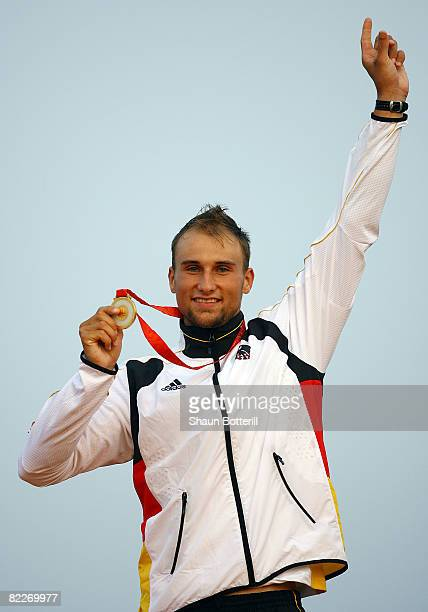 Gold medalist Alexander Grimm of Germany poses with his medal after the Kayak Men's Final held at the Shunyi Olympic RowingCanoeing Park on Day 4 of...