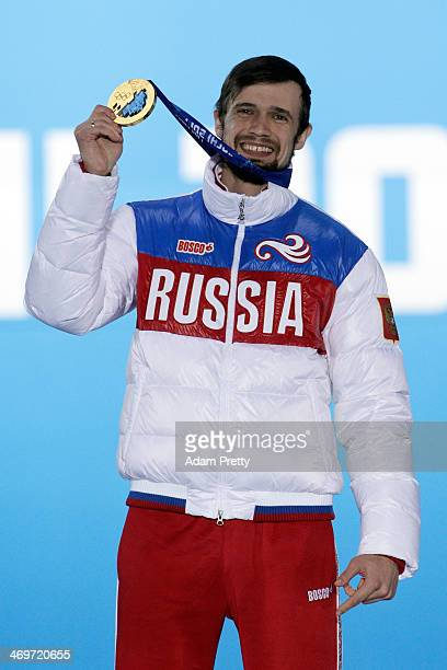 Gold medalist Alexander Tretiakov of Russia celebrates on the podium during the medal ceremony for the Men's Skeleton on day 9 of the Sochi 2014...