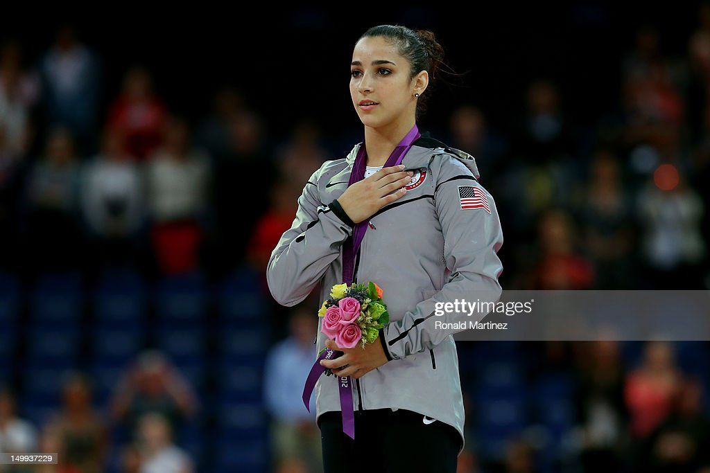 Gold medalist Alexandra Raisman of the United States poses on the podium during the medal ceremony for the Artistic Gymnastics Women's Floor Exercise final on Day 11 of the London 2012 Olympic Games at North Greenwich Arena on August 7, 2012 in London, England.