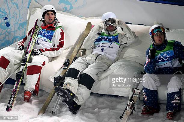 Gold medalist Alexandre Bilodeau of Canada sits with Dale BeggSmith of Australia and Bryon Wilson of United States during the Freestyle Skiing Men's...