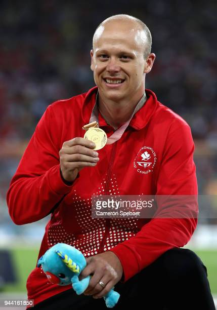 Gold medalist Alexandre Dupont of Canada celebrates during the medal ceremony for the Men's T54 1500 metres during the Athletics on day six of the...