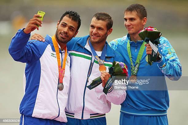 Gold medalist Alexey Mochalov of Uzbekistan Silver medalist Ahmadreza Talebian of Iran and Bronze medalist Yuriy Berezintsev of Kazakhstan take a...