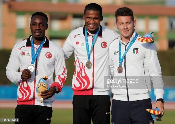 Gold medalist Ali Jak Harvey Silver medalist Zafer Emre Barnes of Turkey and Bronze medalist Federico Catteneo pose during the medal ceremony after...