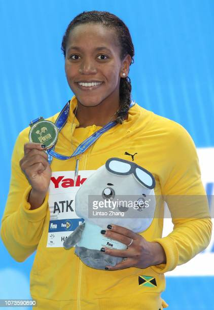 Gold medalist Alia Atkinson of Jamaica poses with her medal during the medal ceremony for the Women's Breaststroke 100m Final on day 5 of the 14th...