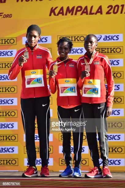 Gold medalist Alice Aprot Nawowuna of Kenya silver medalist Irene Chepet Cheptai of Kenya and bronze medalist Lilian Kasait Rengeruk of Kenya pose at...