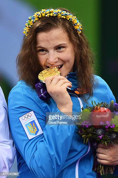 Gold medalist Alina Stadnik Makhynia of Ukraine celebrates with the medal won in the Women's Freestyle 69kg Wrestling Final during day three of the...