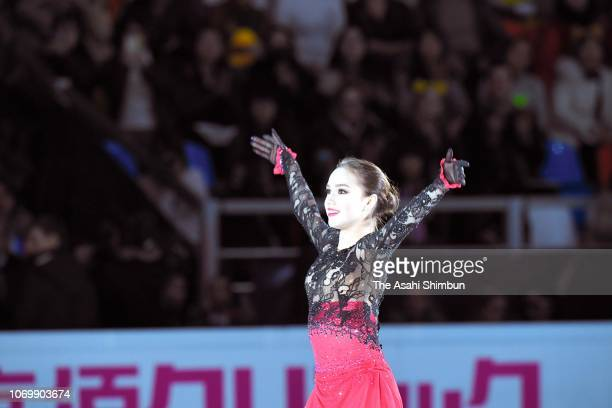 Gold medalist Alina Zagitova of Russia applauds fans prior to the medal ceremony for the Ladies Singles on day three of the ISU Grand Prix of Figure...