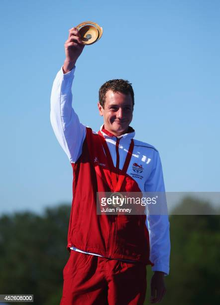 Gold medalist Alistair Brownlee of England celebrates on the podium during the medal ceremony for the Men's Triathlon at Strathclyde Country Park on...