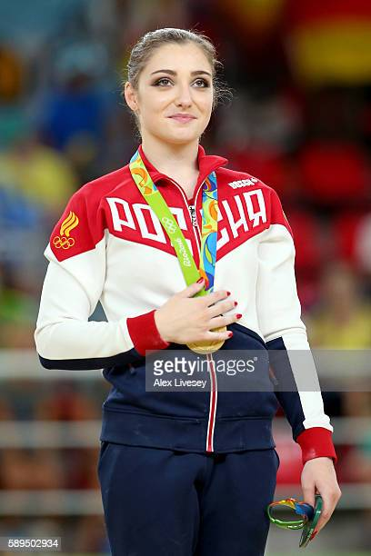 Gold medalist Aliya Mustafina of Russia celebrates on the podium at the medal ceremony for the Women's Uneven Bars on Day 9 of the Rio 2016 Olympic...