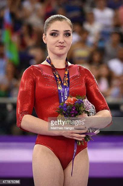 Gold medalist Aliya Mustafina of Russia stands on the podium during the medal ceremony for the the Women's Uneven Bars final on day eight of the Baku...