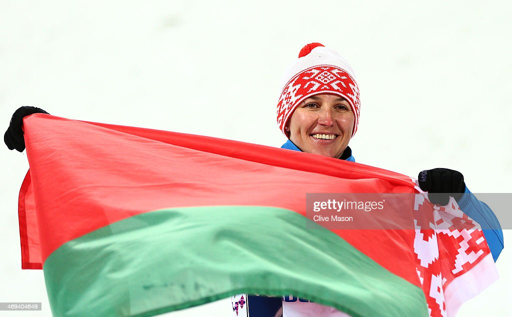 Gold medalist Alla Tsuper of Belarus celebrates during the flower ceremony for the Freestyle Skiing Ladies' Aerials Finals on day seven of the Sochi 2014 Winter Olympics at Rosa Khutor Extreme Park on February 14, 2014 in Sochi, Russia.
