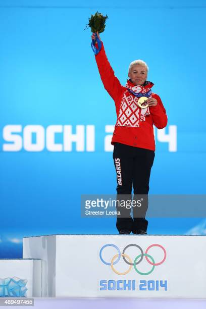 Gold medalist Alla Tsuper of Beralus celebrates on the podium during the medal ceremony for the Freestyle Skiing Ladies' Aerials on day 8 of the...