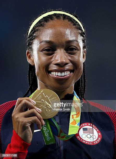 Gold medalist Allyson Felix of the United States stands on the podium during the medal ceremony for the Women's 4 x 400 meter Relay on Day 15 of the...