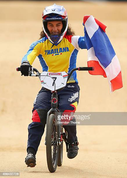 Gold medalist Amanda Mildred Carr of Thailand celebrates following the Women's Motos Final during day twelve of the 2014 Asian Games at Ganghwa Asiad...