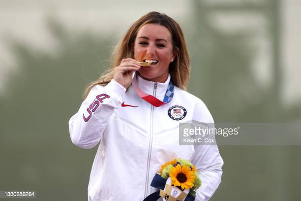 Gold Medalist Amber English of Team United States on the podium during the medal ceremony for the Skeet Women's Finals on day three of the Tokyo 2020...