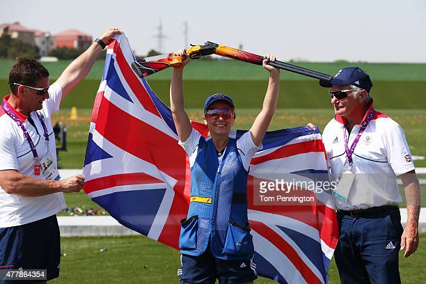 Gold medalist Amber Hill of Great Britain celebrates with coaches Kevin Gill and Joe Neville during the Women's Skeet shooting final during day eight...