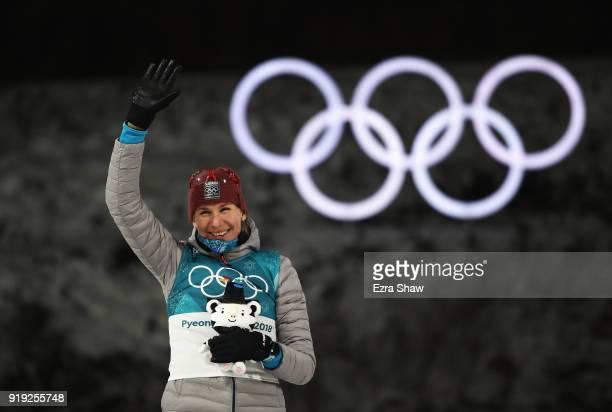Gold medalist Anastasiya Kuzmina of Slovakia celebrates on the podium during the victory ceremony after the Women's 125km Mass Start Biathlon on day...