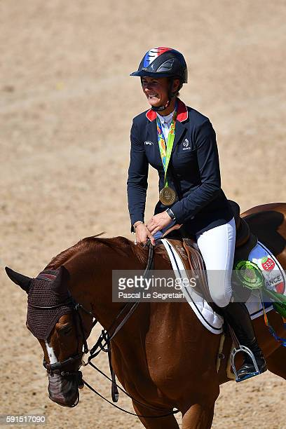 Gold medalist and Olympic Champion Penelope Leprevost of France on Flora de Mariposa waves to the crowd during the round 2 of the Equestrian Jumping...